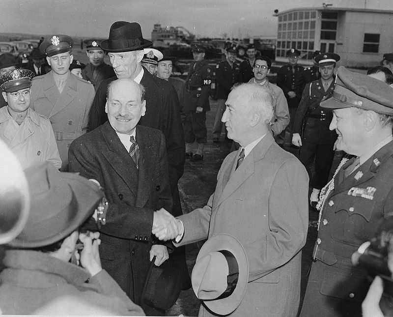 Attlee shaking hands with US Secretary of State James F. Byrnes upon his arrival at National Airport in Washington, 1945