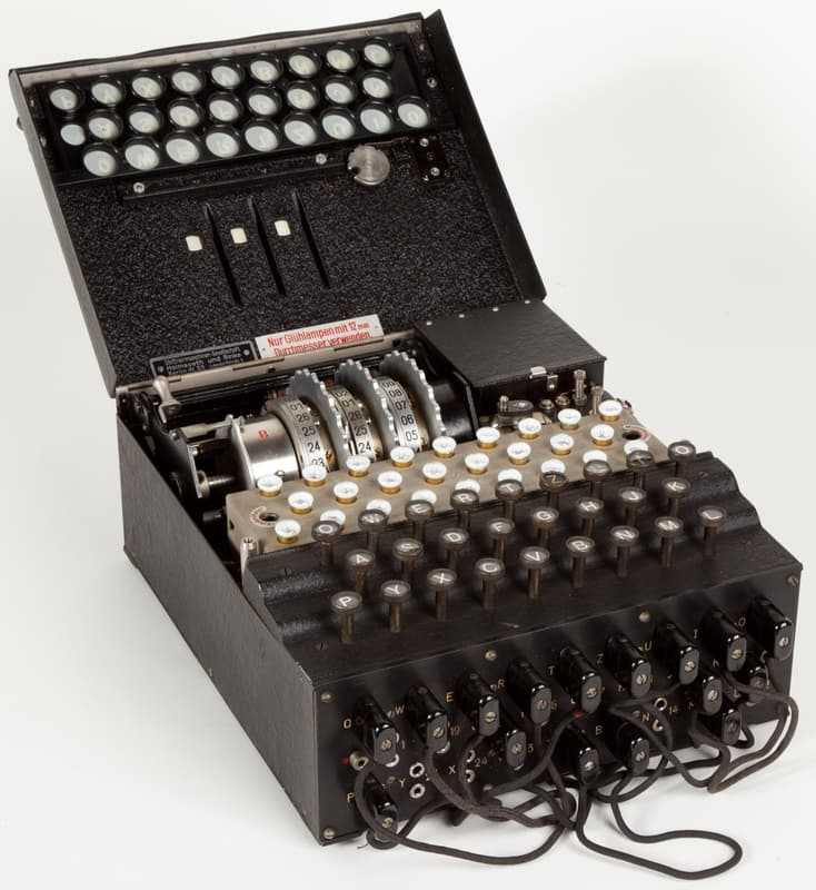 "Encrypting and decryption machine. Exhibited at the ""L. Da Vinci"" national science and technology museum in Milan. The Enigma machine looks like a dark metal box with, on the upper side, a keyboard bearing 26 letters"