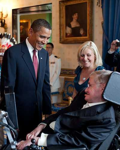 President Barack Obama talks with Hawking in the White House before a ceremony presenting him with the Presidential Medal of Freedom on 12 August 2009