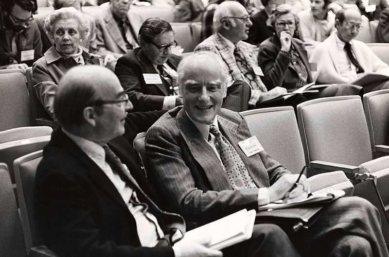 Scientific Symposium, Stanford University School of Medicine: Francis Crick sitting in lecture theatre chatting