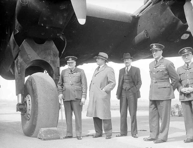 Winston Churchill, in the uniform of an Air Commodore, with Dr H V Evatt (Australian Minister for External Affairs), Clement Attlee (Deputy Prime Minister) and Air Vice-Marshal C R Carr (AOC No 4 Group) during a visit to a Yorkshire-based Halifax squadron on 15 May 1942.
