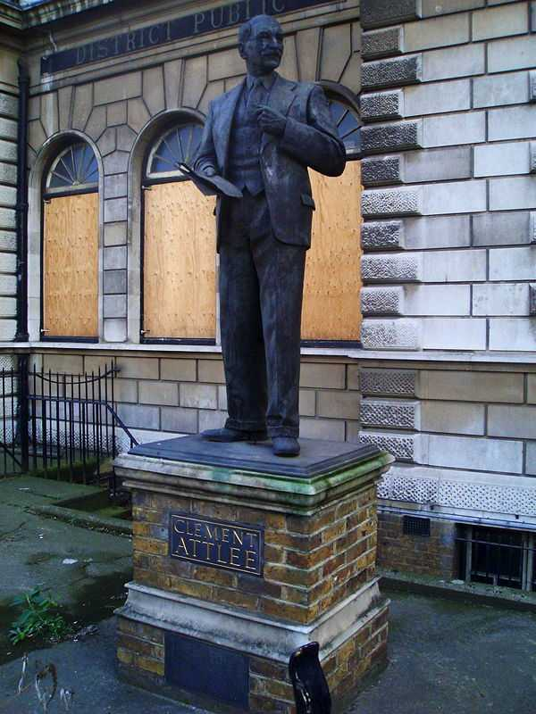 A statue of Clement Attlee outside Limehouse Library, which is boarded up. In April 2011 the statute was unveiled in its new permanent location outside the main library at Queen Mary, University of London.