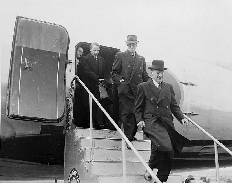 Photograph of British Prime Minister Clement Attlee disembarking from his aircraft upon his arrival at National Airport in Washington in November 1945