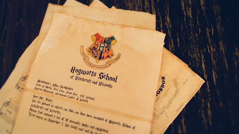 Letter to Dumbledore with the official Hogwarts School of Witchcraft and Wizardry emblem